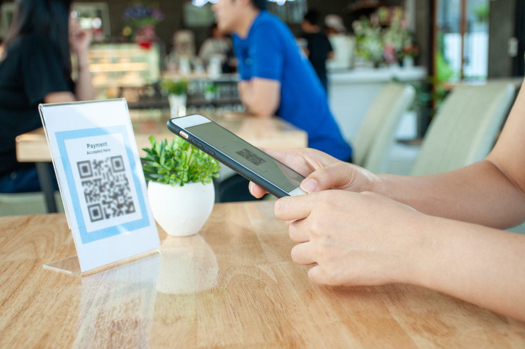 Customer scanning a QR code